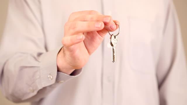 Hand holding keys video