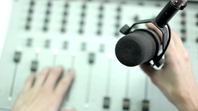 hand holding microphone video