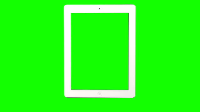 Hand in front of green screen operating a tablet video