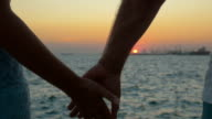 Hand in Hand by the Sea at Sunset video