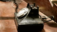 A hand is dialing the old phone. video