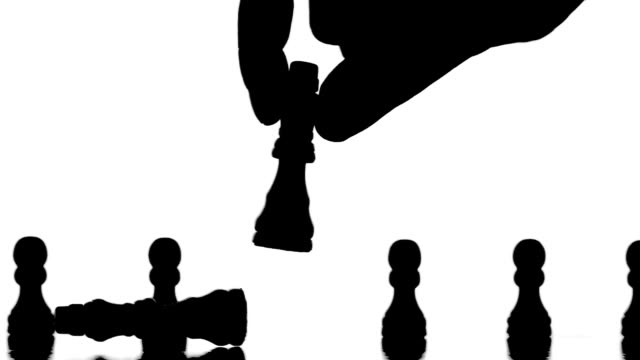 Hand knocking over chess piece video