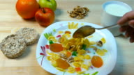 Hand mixing flakes in a bowl. Healthy breakfast video