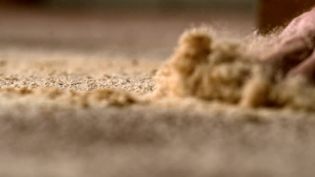 Hand moving dust over carpet video