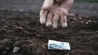 SLO MO Hand of a bankrupt farmer video