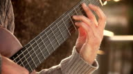 hand of a guitarist playing an acoustic guitar: street artist video