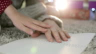 Hand of a little girl fondling old hands of grandmother with love. video