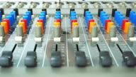 Hand of a man working with the mixing control panel video