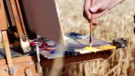 hand of a painter and color palette - painting video