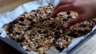 Hand of a woman touching granola video