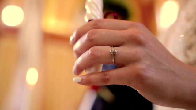 Hand of Bride with Ring and Candle in Church video