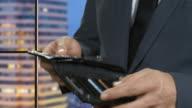 Hand of businessman holding dollar. video