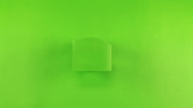Hand of female put a white photo paper on green screen background video