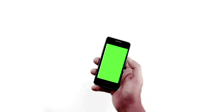 hand of man holding mobile smart phone with chroma key green screen on white background video