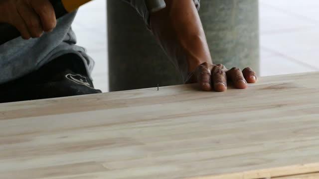 Hand of man worker hammering video