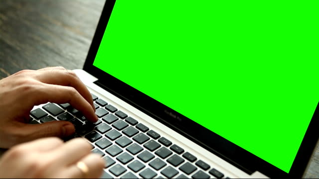 Hand of man working at laptop computer typing on keyboard video
