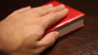 hand on a bible video