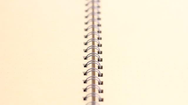 Hand open a blank book video