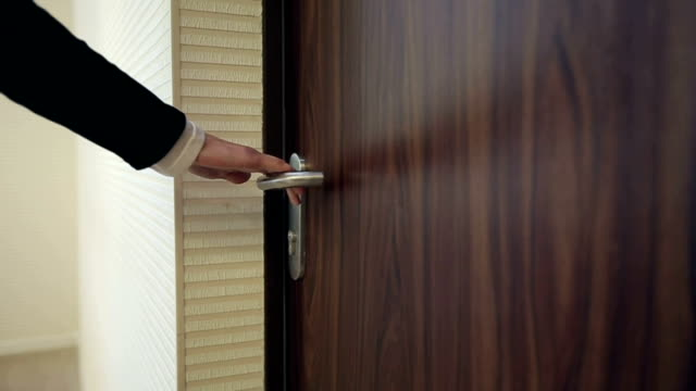 Hand open door in a office. Slow motion video
