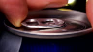 Hand opens a can of beer video