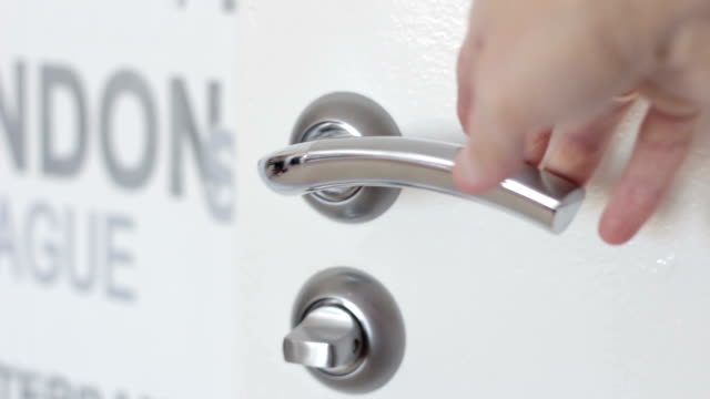 Hand opens a white Door with the door Handle video