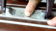 hand opens old suitcase combination lock video