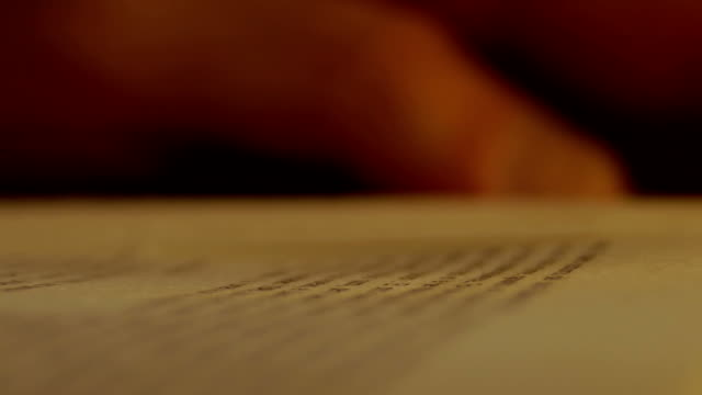 Hand over book while reading. Close Up, Detail video