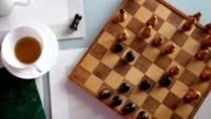 Hand playing chess top view video