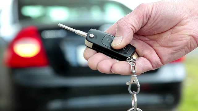Hand pushing on car alarm key system video