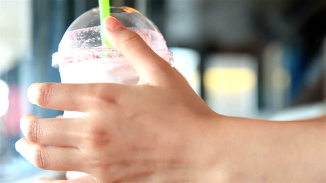 HD: hand put and hold ice tea on table. video