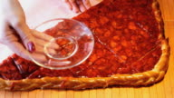 Hand puts piece of the strawberry pie on a saucer video