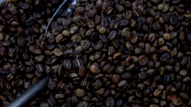 Hand roasting coffee beans in pan,Slow motion video