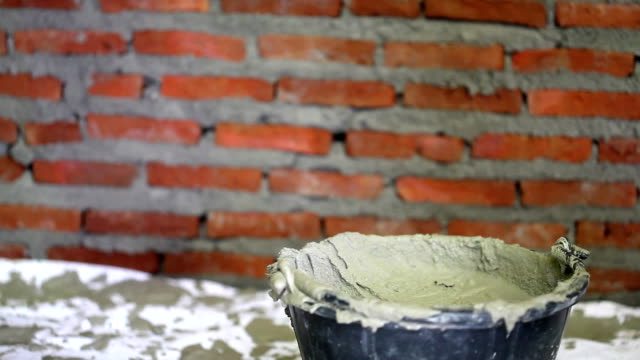 Hand shoveled cement. video