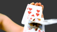 Hand shuffling and pushing cards towards the camera video