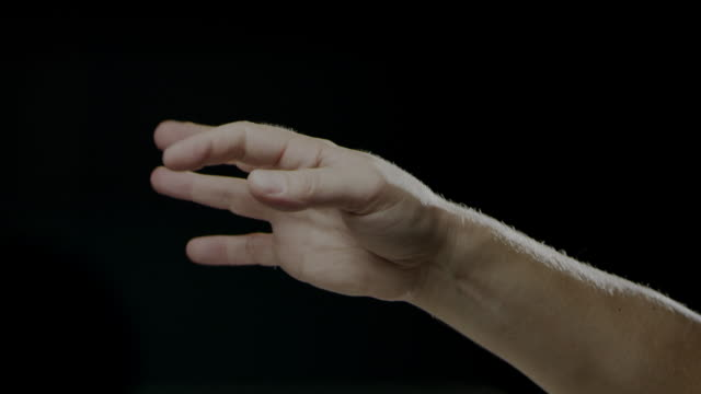 Hand signs language black background slow motion caucasian human video