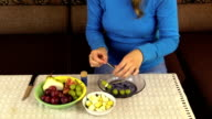 hand string grape pear fruit on  stick and put pan on table video