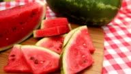 Hand take slice of fresh watermelon video