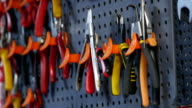 Hand Take Variety of tools organized on wall video