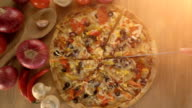 Hand taking slice of vegetarian pizza top view video