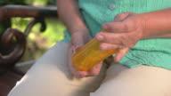 Hand taking white pills. video
