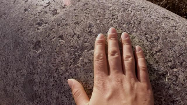 Hand touches  ideally polished surface of ancient column antique town Salamis east Cyprus Famagusta video
