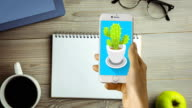 Hand touching digitally generated icon on mobile phone video