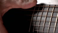 Hand touching guitar strings. Music performance. Super slow motion macro video video