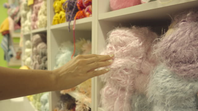 hand touching wool video
