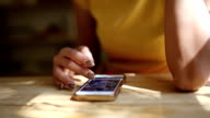 Hand using smartphone. video