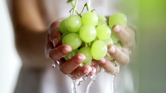 Hand washing grapes in slow motion   FO video