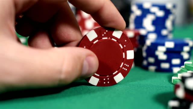 Hand With Red Poker Chips video