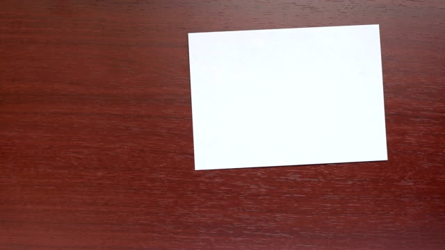 hand with white envelope video