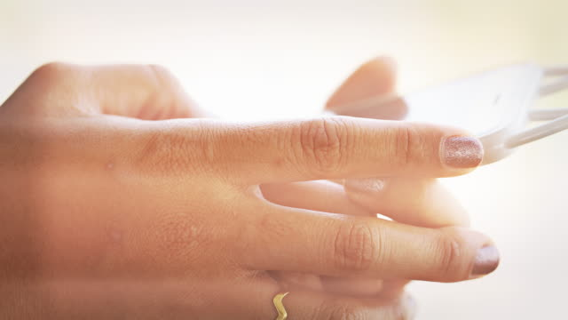 Hand Woman playing mobile phone video