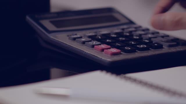 Hand working calculator video
